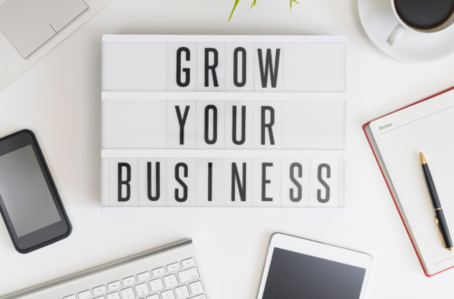 """A plaque displaying the words """"grow your business"""""""